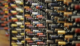 FILE - In this June 16, 2016, file photo, bottles of wine are displayed during a tour of a state liquor store, in Salt Lake City. Cheap liquor, wine and beer have long been best-sellers among Utah alcohol drinkers, but new numbers from Utah's tightly-controlled liquor system show local craft brews, trendy box wines and flavored whiskies are also popular choices in a largely teetotaler state. (AP Photo/Rick Bowmer, File)