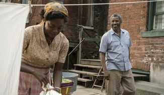 "This image released by Paramount Pictures shows Denzel Washington, right, and Viola Davis in a scene from ""Fences,"" directed by Washington. (David Lee/Paramount Pictures via AP)"