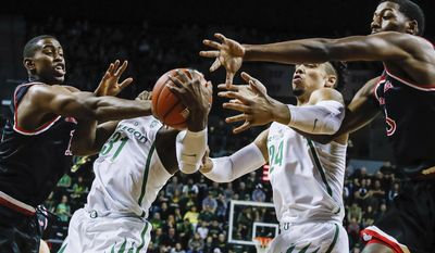 Fresno State forward Bryson Williams, left, Oregon guard Dylan Ennis (31) and forward Dillon Brooks, (24), and Fresno State guard Paul Watson, right, vie for a ball in an NCAA college basketball game Tuesday, Dec. 20, 2016, in Eugene, Ore. (AP Photo/Thomas Boyd)