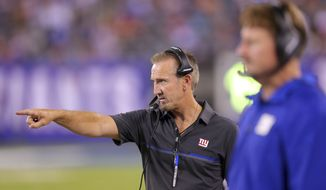 FILE - In this Aug. 12, 2016, file photo, New York Giants defensive coordinator Steve Spagnuolo gestures during an NFL preseason game against the Miami Dolphins at MetLife Stadium in East Rutherford, N.J. There's plenty at stake when the Giants (10-4) visit Philadelphia (5-9) on Thursday night. Spagnuolo, who spent eight seasons as an assistant coach with the Eagles, began his second stint with the Giants last year and has turned one of the league's worst defenses into one of the better units. (AP Photo/Brad Penner, File)