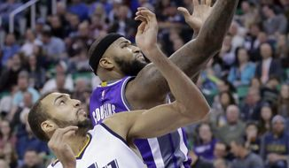 Utah Jazz center Rudy Gobert (27) defends against Sacramento Kings forward DeMarcus Cousins, rear, in the first half during an NBA basketball game Wednesday, Dec. 21, 2016, in Salt Lake City. (AP Photo/Rick Bowmer)