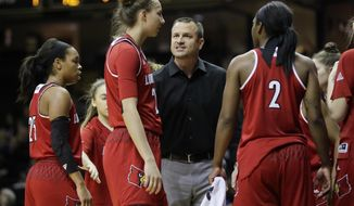 Louisville coach Jeff Walz talks to forward Kylee Shook during the first half of an NCAA college basketball game against Vanderbilt on Wednesday, Dec. 21, 2016, in Nashville, Tenn. (AP Photo/Mark Humphrey)