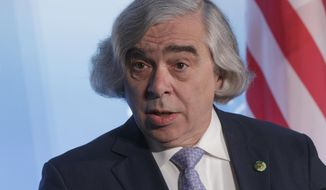 FILE - In this April 1, 2016 file photo, Energy Secretary Ernest Moniz speaks at the Nuclear Security Summit in Washington.  The Energy Department said Wednesday it is offering a conditional, $2 billion loan guarantee to capture and store carbon dioxide at a planned Louisiana methanol plant, a new element of the Obama's administration's strategy to slow global warming.  (AP Photo/J. Scott Applewhite)