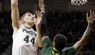 Purdue center Isaac Haas (44) shoots over Norfolk State forward Stavian Allen (13) during the first half of an NCAA college basketball game in West Lafayette, Ind., Wednesday, Dec. 21, 2016. (AP Photo/Michael Conroy)