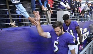 FILE - In this Oct. 9, 2016, file photo, Baltimore Ravens' Joe Flacco greets fans as he walks to the locker room after losing an NFL football game to the Washington Redskins, in Baltimore.  It's been an inconsistent season for Ravens quarterback Joe Flacco, who's poised for his first 4,000-yard season but has also thrown 13 interceptions. Flacco must be sharp Sunday in a first-place showdown in Pittsburgh. (AP Photo/Nick Wass, File)
