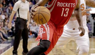 Houston Rockets guard James Harden (13) drives against the Phoenix Suns during the first half of an NBA basketball game, Wednesday, Dec. 21, 2016, in Phoenix. (AP Photo/Matt York)