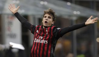 FILE - In this Saturday, Oct. 22, 2016 filer, AC Milan's Manuel Locatelli celebrates after scoring during a Serie A soccer match between AC Milan and Juventus, at the San Siro stadium in Milan, Italy. Defending champions Juventus will play AC Milan for the Italian Super Cup in Doha on Friday, Dec. 23, 2016. (AP Photo/Luca Bruno, File)