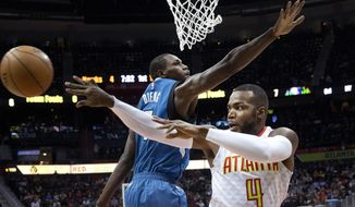 Atlanta Hawks forward Paul Millsap (4) passes against Minnesota Timberwolves forward Gorgui Dieng (5) in the first half of an NBA basketball game Wednesday, Dec. 21, 2016, in Atlanta. (AP Photo/John Bazemore)