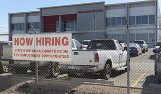 ADVANCE FOR SUNDAY, DEC. 25, 2016- In this Friday, Dec. 16, 2016 photo, prospects for employment in the oil field are beginning to have positive signs as indicated by this hiring sign in front of the Halliburton facility in Odessa, Texas. (Mark Sterkel/Odessa American via AP)