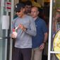 President Barack Obama walks out of Island Snow after paying a visit to get shave ice during a family vacation on Sunday, Dec. 27, 2015, in Kailua, Hawaii. (AP Photo/Evan Vucci)
