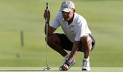 President Barack Obama prepares to putt on the 18th green at Kapolei Golf Club on Wednesday in Kapolei, Hawaii. (Associated Press)