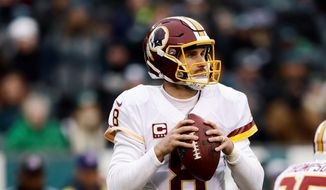 Washington Redskins quarterback Kirk Cousins broke his franchise record for passing yards on Monday against the Carolina Panthers and sits at 4,360 with two games to go. (Associated Press)