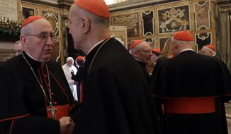 "Pope Francis greets Cardinals and Bishops on the occasion of his Christmas greetings to the Roman Curia in the Clementine Hall, at the Vatican, Thursday, Dec. 22, 2016. The pontiff denounced the resistance hes encountering in reforming the Vatican bureaucracy, saying some of it is inspired by the devil and that the prelates who work for him must undergo ""permanent purification"" to serve the Catholic Church better. (AP Photo/Gregorio Borgia, Pool)"