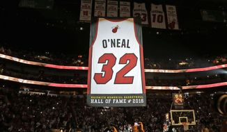 Retired Hall of Fame basketball player Shaquille O'Neal's jersey is raised during halftime at an NBA basketball game between the Los Angeles Lakers and the Miami Heat, Thursday, Dec. 22, 2016, in Miami. The Heat retired O'Neal's No. 32 jersey. (AP Photo/Alan Diaz)