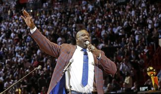 Retired Hall of Fame basketball player Shaquille O'Neal shouts and waves to the fans after his jersey was raised during halftime at an NBA basketball game between the Los Angeles Lakers and the Miami Heat, Thursday, Dec. 22, 2016, in Miami. The Heat retired O'Neal's No. 32 jersey. (AP Photo/Alan Diaz)