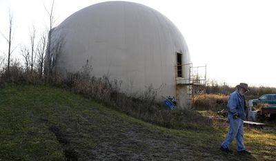 In this Nov. 29, 2016 photo, Wayne Price, 60, walks outside the the 4,650 square feet concrete monolithic dome he was in the processes of building in Otisville, Mich. Financial realities have forced Price to abandon his dream of finishing, and living in, a dome home. Price is selling the unfinished monolithic domed structure for $150,000 after he estimates sinking roughly $200,000 in the project over 16 years (Tegan Johnston/The Flint Journal-MLive.com via AP)