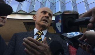 Former Los Angeles County Sheriff Lee Baca, talks to members of the media as he walks out of a federal courthouse in downtown Los Angeles Thursday, Dec. 22, 2016. A federal judge declared a mistrial Thursday in the corruption trial of Baca after jurors said they were hopelessly deadlocked. (AP Photo/Brian Melley)