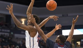 Old Dominion's Zoran Talley drives to the basket but has the ball knocked away by a Howard player during the first half of an NCAA college basketball game Thursday, Dec. 22, 2016, in Norfolk, Va. (Bill Tiernan/The Virginian-Pilot via AP)