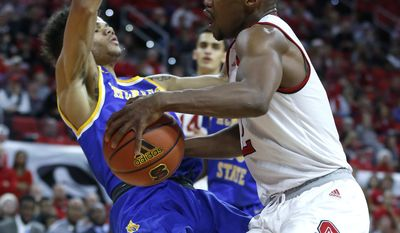 North Carolina State's Torin Dorn (2) gains space as McNeese's Kalob Ledoux (11) falls while guarding him during the first half of an NCAA college basketball game, Thursday, Dec. 22, 2016 in Raleigh, N.C. (Ethan Hyman/The News & Observer via AP)