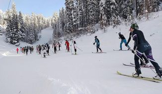 In this Dec. 16, 2016 photo, ski mountaineering racers make their way up the 45th Parallel run during the Northwest Passage Ski Mountaineering Vertical Race at Brundage Ski resort in McCall, Idaho. The vertical race featured a sprint to the top of the mountain that included 530 meters of elevation gain. (Kyle Green/Idaho Statesman via AP)