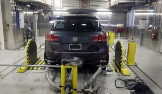 FILE - In this Oct. 13, 2015, file photo, a Volkswagen Touareg diesel is tested in the Environmental Protection Agency's cold temperature test facility in Ann Arbor, Mich. A federal judge says Volkswagen has reached a deal to compensate owners and leaseholders of the remaining 80,000 diesel vehicles caught up in the company's emissions cheating scandal. But U.S. District Judge Charles Breyer didn't say Thursday, Dec. 22, 2016, how much the owners and leaseholders would receive on top of a buyback or repairs of their cars. (AP Photo/Carlos Osorio, File)