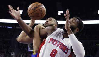 Golden State Warriors center JaVale McGee and Detroit Pistons center Andre Drummond (0) vie for a rebound during the first half of an NBA basketball game, Friday, Dec. 23, 2016, in Auburn Hills, Mich. (AP Photo/Carlos Osorio)