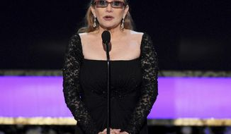 FILE - In this Sunday, Jan. 25, 2015 file photo, Carrie Fisher presents the life achievement award on stage at the 21st annual Screen Actors Guild Awards at the Shrine Auditorium in Los Angeles. Fisher has reportedly been transported to a hospital after suffering a severe medical emergency on a flight Friday, Dec. 23, 2016. (Photo by Vince Bucci/Invision/AP, File)