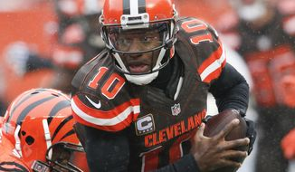 FILE - In this Dec. 11, 2016, file photo, Cleveland Browns quarterback Robert Griffin III runs in the first half of an NFL football game against the Cincinnati Bengals, in Cleveland. The Browns play the San Diego Chargers on Sunday, Dec. 25.  (AP Photo/Ron Schwane, File)