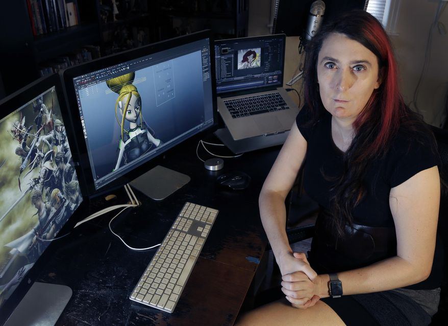 Brianna Wu, a software engineer and video-game developer, sits at her workstation in Boston, in this July 25, 2016, file photo. Wu, the co-founder of a gaming software company who made headlines two years ago when she was threatened, said she wants to run for one of Massachusetts' nine U.S. House seats. Wu said her platform will focus on privacy rights and online harassment. (AP Photo/Elise Amendola, File)