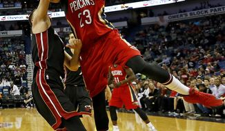 New Orleans Pelicans forward Anthony Davis (23) shoots over Miami Heat forward Josh McRoberts, left, in the first half of an NBA basketball game in New Orleans, Friday, Dec. 23, 2016. (AP Photo/Max Becherer)