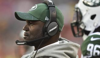 "FILE - In this Oct. 30, 2016, file photo, New York Jets coach Todd Bowles stands on the sideline during the team's NFL football game against the Cleveland Browns in Cleveland. Bowles has been hospitalized with what the team says is an ""undisclosed illness,"" and he did not travel for the game at New England on Saturday. In a statement posted Friday, Dec. 23, on the team's website, the Jets say Bowles is in stable condition, but it is uncertain if he will eventually join the team in time for the game. (AP Photo/David Richard, File)"