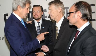 """FILE- In this Oct. 20, 2016, file, U.S. Secretary of State John Kerry, left, Leonardo Dicaprio, second from left, Piers Sellers and Fisher Stevens, from left, attend the premiere of National Geographic Channel's """"Before The Flood,"""" at the United Nations headquarters. Sellers, a climate scientist and former astronaut died Friday, Dec. 23. He was 61. (Photo by Brad Barket/Invision/AP, File)"""