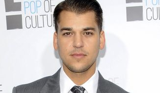 """FILE - In this April 30, 2012 file photo, Rob Kardashian from the show """"Keeping Up With The Kardashians"""" attends an E! Network upfront event in New York. Rob Kardashian says in an Instagram post Saturday, Dec. 17, 2016 that fiancee Blac Chyna has left him and taken their month-old daughter with her.  (AP Photo/Evan Agostini, File)"""