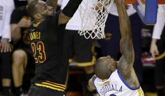 FILE - In this June 19, 2016 file photo, Cleveland Cavaliers forward LeBron James (23) blocks a shot by Golden State Warriors forward Andre Iguodala (9) during the second half of Game 7 of basketball's NBA Finals in Oakland, Calif. James had three blocked shots, including this key one against Iguodala on a fast break in the final minutes. (AP Photo/Eric Risberg, File)