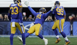 Los Angeles Rams defensive tackle Dominique Easley (91) celebrates after sacking San Francisco 49ers quarterback Colin Kaepernick during the first half of an NFL football game, Saturday, Dec. 24, 2016, in Los Angeles. (AP Photo/Jae C. Hong)