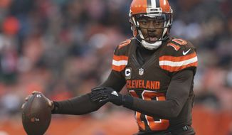 Cleveland Browns quarterback Robert Griffin III (10) looks to pass in the second half of an NFL football game against the San Diego Chargers, Saturday, Dec. 24, 2016, in Cleveland. (AP Photo/Aaron Josefczyk)