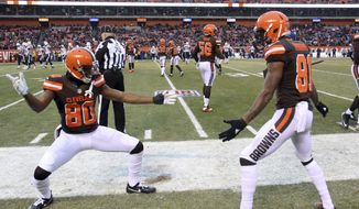 Cleveland Browns wide receiver Ricardo Louis (80) and wide receiver Rashard Higgins (81) celebrate after making a tackle on a punt in the second half of an NFL football game against the San Diego Chargers, Saturday, Dec. 24, 2016, in Cleveland. (AP Photo/Aaron Josefczyk)