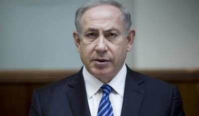 """In this Dec. 11, 2016, photo, Israeli Prime Minister Benjamin Netanyahu attends the weekly cabinet meeting at his office in Jerusalem. Netanyahu lashed out at President Barack Obama on Saturday, Dec. 24, accusing him of a """"shameful ambush"""" at the United Nations over West Bank settlements and saying he is looking forward to working with his """"friend"""" President-elect Donald Trump. Netanyahu's comments came a day after the United States broke with past practice and allowed the U.N. Security Council to condemn Israeli settlements in the West Bank and east Jerusalem as a """"flagrant violation"""" of international law. (Abir Sultan, Pool via AP, File)"""