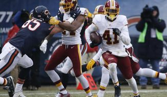 Washington Redskins free safety Will Blackmon (41) returns an interception against the Chicago Bears during the second half of an NFL football game, Saturday, Dec. 24, 2016, in Chicago. (AP Photo/Nam Y. Huh)