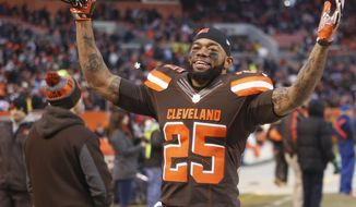 Cleveland Browns running back George Atkinson (25) celebrates after the Browns defeated the San Diego Chargers in an NFL football game, Saturday, Dec. 24, 2016, in Cleveland. (AP Photo/Ron Schwane)