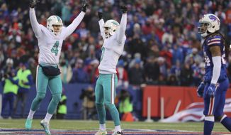 Miami Dolphins punter Matt Darr (4) and Miami Dolphins kicker Andrew Franks (3) celebrate after kicking a field goal during an NFL football game against the Buffalo Bills in Orchard Park, N.Y. on Saturday, Dec. 24, 2016. (Al Diaz/Miami Herald via AP)