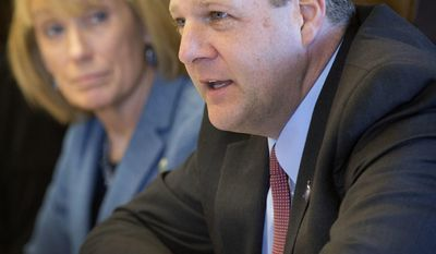 FILE - In this Friday, Nov. 18, 2016 file photo New Hampshire Democratic Gov. Maggie Hassan, left, looks on as Republican N.H. Gov.-elect Chris Sununu, right, speaks at the Governor's agency budget hearings, in Concord, N.H. With Republicans strengthening their grip on power in the November elections, Sununu will be paired with a GOP-led legislature (AP Photo/Jim Cole, File)