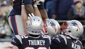 New England Patriots running back LeGarrette Blount gets a lift from teammates including Joe Thuney, left, and Shaq Mason, right, to celebrate his touchdown run against the New York Jets during the second half of an NFL football game, Saturday, Dec. 24, 2016, in Foxborough, Mass. (AP Photo/Charles Krupa)