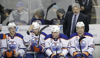 Edmonton Oilers coach Todd McLellan, top right, argues a call during the first period of the team's NHL hockey game against the San Jose Sharks on Friday, Dec. 23, 2016, in San Jose, Calif. (AP Photo/Marcio Jose Sanchez)