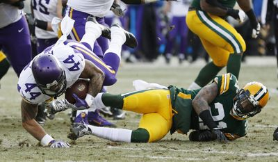 Minnesota Vikings' Matt Asiata is tripped up by Green Bay Packers' Ha Ha Clinton-Dix during the first half of an NFL football game Saturday, Dec. 24, 2016, in Green Bay, Wis. (AP Photo/Matt Ludtke)