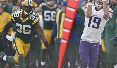 Minnesota Vikings' Adam Thielen catches a pass in front of Green Bay Packers' LaDarius Gunter during the first half of an NFL football game Saturday, Dec. 24, 2016, in Green Bay, Wis. (AP Photo/Matt Ludtke)