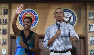 President Barack Obama and first lady Michelle Obama, arrive for an event to thank service members and their families at Marine Corps Base Hawaii, in Kaneohe Bay, Hawaii, Sunday, Dec. 25, 2016. (AP Photo/Carolyn Kaster)