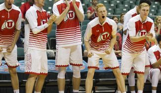The Utah bench reacts after a Stephen F. Austin player was called for a charging foul during the first half of an NCAA college basketball game at the Diamond Head Classic, Sunday, Dec. 25, 2016, in Honolulu. (AP Photo/Eugene Tanner)