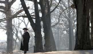 Revolutionary War re-enactor Patrick Jordan, as Col. Paul Sargent of the 16th Massachusetts Continental regiment, stands in morning mist looking over the Delaware River before the re-enactment of Gen. George Washington's Christmas Day crossing to New Jersey on Sunday, Dec. 25, 2016, in Washington Crossing, Pa. (AP Photo/Mel Evans)