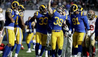 Los Angeles Rams defensive back Cody Davis (38) celebrates after a interception against the San Francisco 49ers during the first half of an NFL football game, Saturday, Dec. 24, 2016, in Los Angeles. (AP Photo/Jae C. Hong)